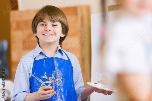 Cute boy painting