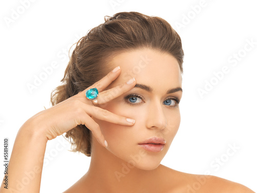 woman with blue cocktail ring
