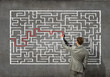 Businessman solving labyrinth problem