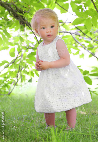Little farmer girl under wallnut tree