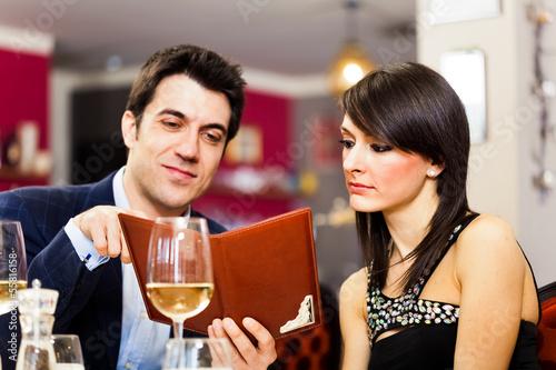 Couple reading menu