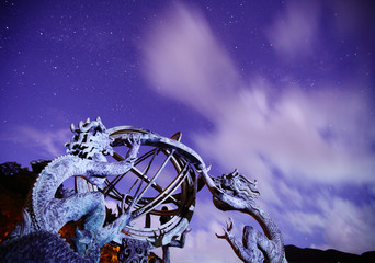 Armillary sphere with galaxy sky