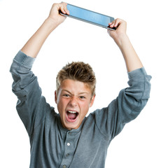 Angry teen raising tablet.