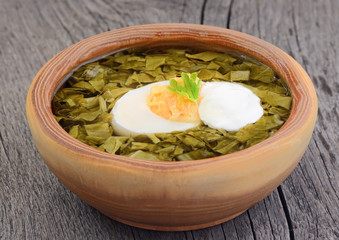 Sorrel soup with egg and sour cream