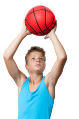 teen sportsman holding basketball.