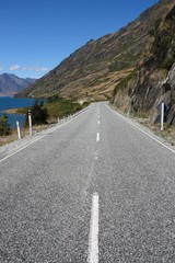 Road next to lake Hawea in New Zealand