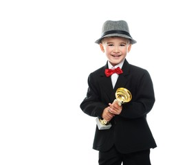 Happy boy in black suit holding prize cup
