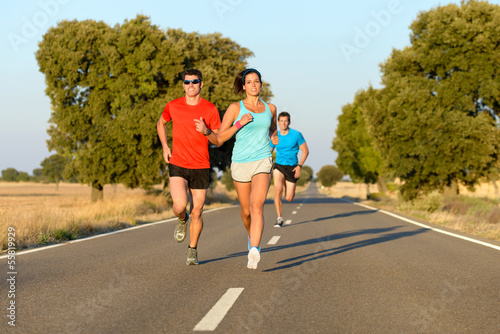 Sport people running in road