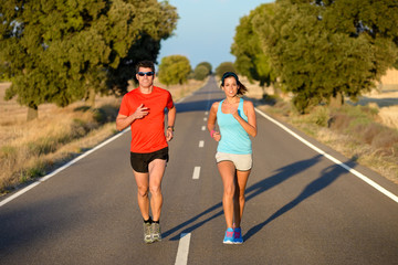Sport couple running in road