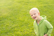 Happy child over green grass