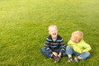 Happy children on green grass