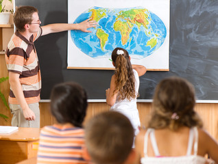 Young teacher at geography lesson