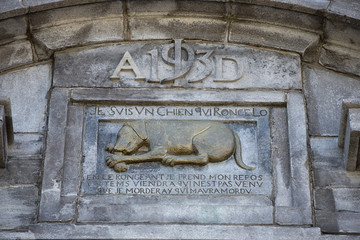dog monument bas relief