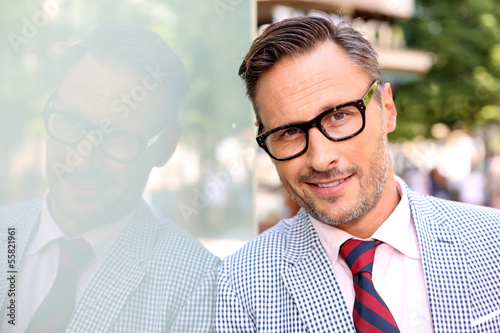 Portrait of trendy guy with eyeglasses and tie
