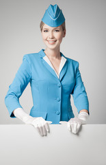 Charming Stewardess Dressed In Blue Uniform With Blank Form On G
