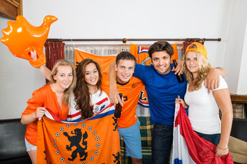 Happy Dutch Soccer Fans Standing Together At Home