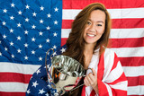 Beautiful Sportswoman Holding Trophy Against North American Flag