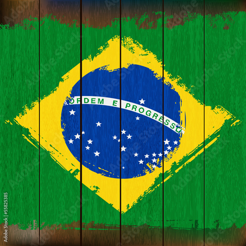 Grunged Brazilian Flag over a wooden plank  background