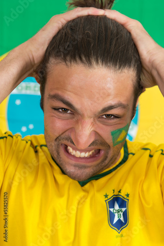 Brazilian sports fan in dispair