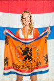 Dutch Sports fan Holding Cheering Flag in Front of Holland Flag