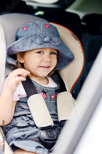 happy child in car seat