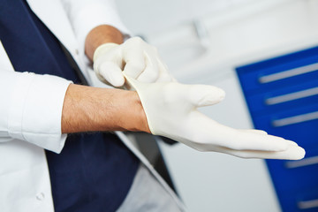 Dentist putting on gloves