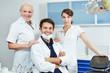 Dentist with his dental team
