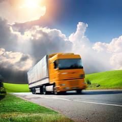 yellow truck on the asphalt road