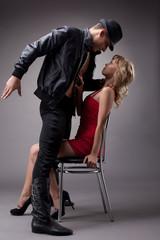 Artistic couple of dancers posing in studio