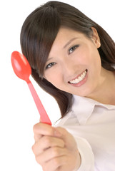 Business woman with tablespoon