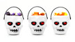 Three Halloween skull candy holders with candy corn