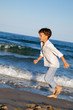 Child are running on beach