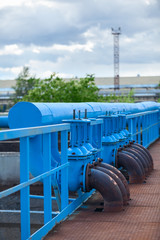 Many blue pipelines with stop-gate valves at industrial plant