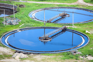 Blue water in an industrial wastewater treatment circular tanks