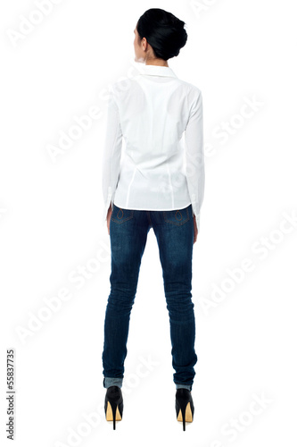 Young woman in casuals, rear view
