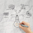 woman hand draw the big idea diagram on crumpled paper backgroun