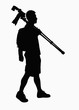 Silhouette of man carrying camera and tripod.