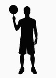Silhouette of basketball player spinning basketball on finger.