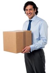 Male executive holding cardboard box