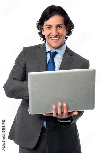 Businessman operating his laptop