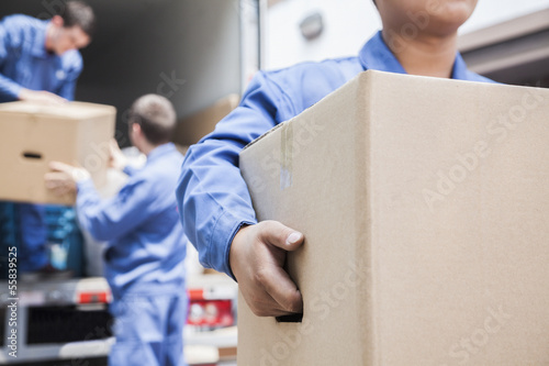 Poster Movers unloading a moving van