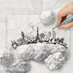 crumpled paper and traveling around the world