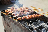 skewers of pork on wooden sticks