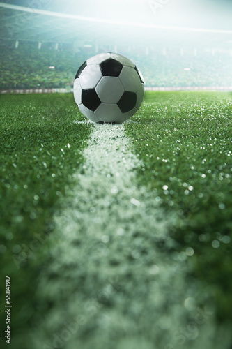 Soccer field with soccer ball and line, side view