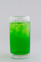 Green fruit flavor soft drinks whit soda water isolated on white