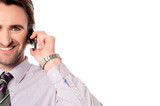 Male executive speaking over mobile phone