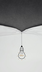 pencil lightbulb draw rope open wrinkled paper show blank black