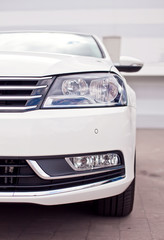 Closeup photo of a white car's headlight