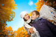 Mom with son in a yellow autumn park