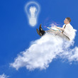 Internet Education. Businessman on the cloud
